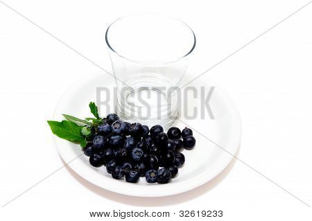 Fresh Picked Blueberries And Empty Glass