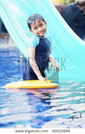 Cute Asian Kid Posing At Swimming Pool