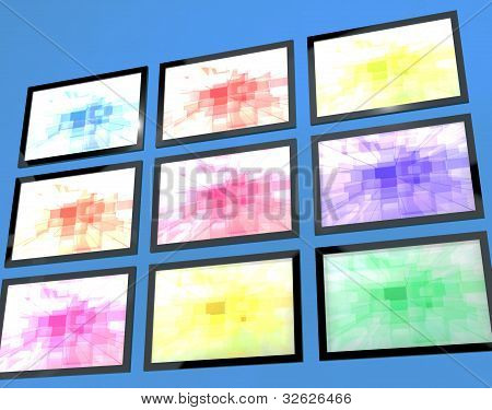 Nine TV Monitors Wall Mounted In Different Colors Representing High Definition Televisions Or HDTVs