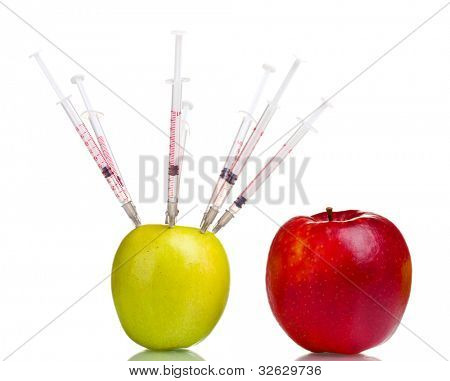 green apple and syringes and red apple isolated on white