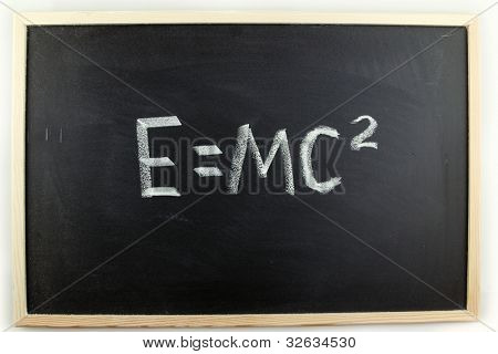 Formula written in chalk on blackboard