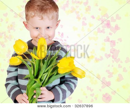 Cute Little Boy With Yellow Tulips