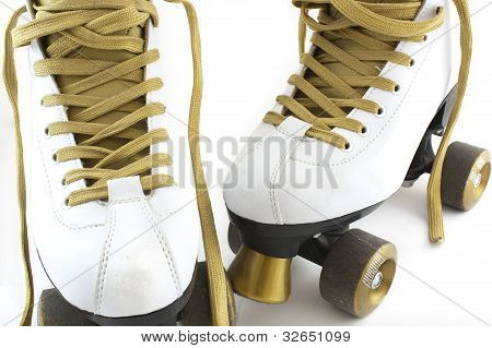 Gold And White Rollerskates