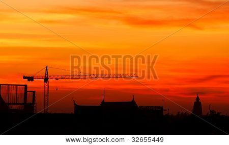 Industrial Construction Cranes And Building At Sunrise