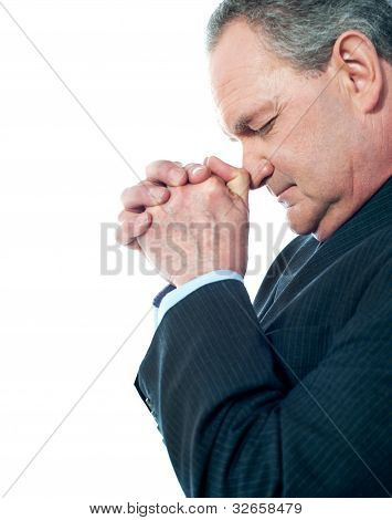 Portrait Of Matured Businessman Praying