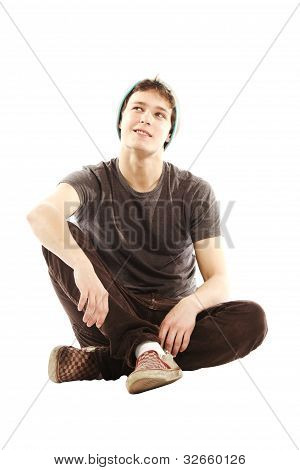 Young Man Dressed In Hip Style Contemplative