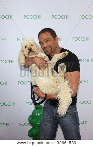 LOS ANGELES, CA - MAY 3: Steven Kay at the grand opening of the Pooch Hotel on May 3, 2012 in Hollywood, Los Angeles, CA. The Pooch Hotel is billed as a luxury hotel and daycare exclusively for dogs.