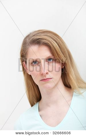 Portrait Of Pretty Blonde Girl With Serious Look