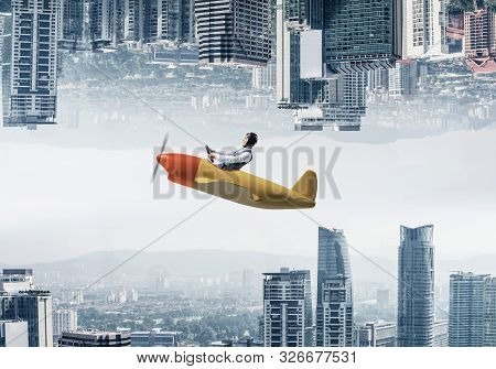 poster of Businessman Flying In Small Airplane. Two Modern Urban Worlds Located Upside Down To Each Other. Fun