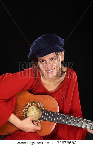 Smiling Woman Playing the Guitar
