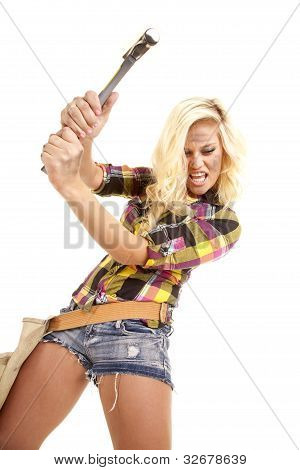 Woman Swinging A Hammer Looking Down