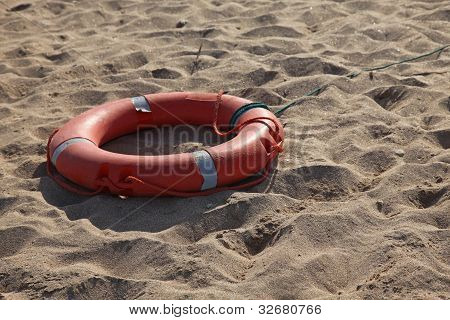Lifebelt on sand