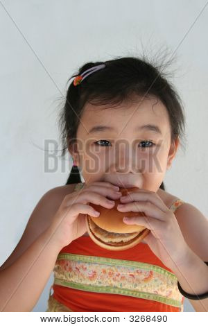 Girl Biting Hamburger
