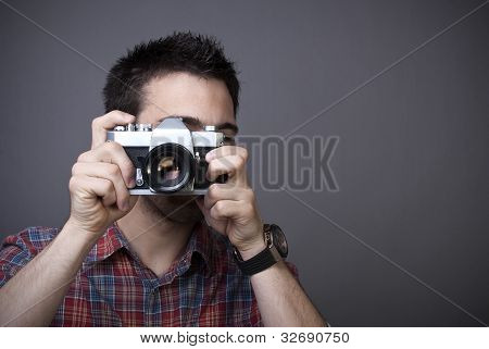 Young Man With Retro Photo Camera