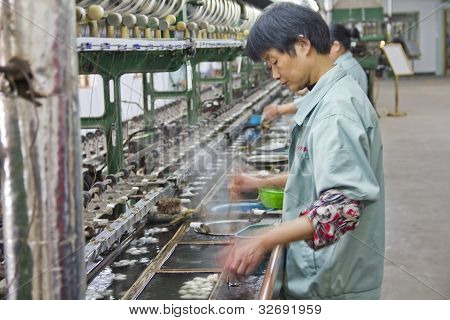 Chinese Worker Detaching Silk Cocoons