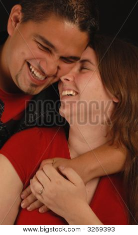 Young Ethnic Mixed Engaged Couple Laughing