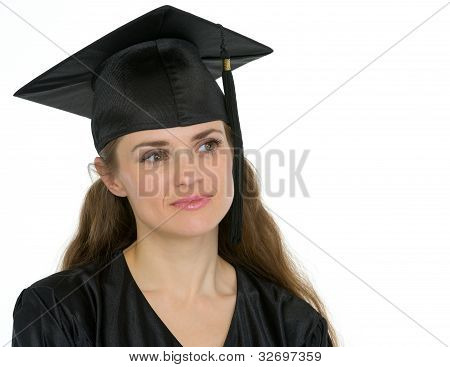 Portrait Of Thoughtful Graduation Woman Looking On Copy Space