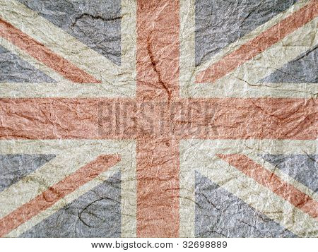 Union Jack flag overlaid onto rough textured paper