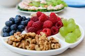Healthy Nutrition, Berries And Nuts. Wild Strawberries, Grapes, Blueberries, Walnuts, Pistachios. Ec poster