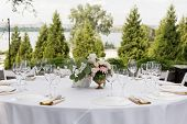Wedding Table Setting Decorated With Fresh Flowers In A Brass Vase. Wedding Floristry. Banquet Table poster