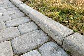 Close-up Of Slab Stone Paved Path Way At Park Or Backyard. Walkway Footpath Road At House Yard Garde poster