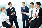 stock photo of semi-formal  - Business people interacting with each other in semi - JPG