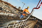 stock photo of formwork  - builder worker standing near trailer - JPG
