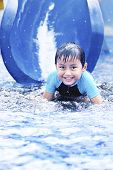 foto of summer fun  - Happy asian boy having fun with water slide during summer - JPG