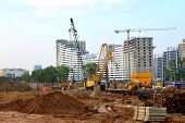 Huge Construction Site With A Lot Of Construction Equipment, Houses Under Construction, Tower Cranes poster