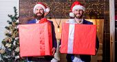 Size Matters. Men Santa Carry Big Gift Boxes. Biggest Gift For Christmas. Big Wrapped Box With Ribbo poster