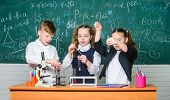 Boy And Girls Enjoy Chemical Experiment. Organic Chemistry Is Study Of Compounds Containing Carbon.  poster