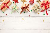 Christmas background with gift boxes and Christmas decorations and  on white wooden background. Wint poster