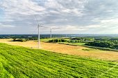 Wind Power Station. Wind Generators Stand In Agricultural Fields. Wonderful Landscape Shot From A Gr poster
