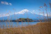 Japan Travel, Mt Diamond Fuji And Snow At Kawaguchiko Lake In Japan, Mt Fuji Is One Of Famous Place  poster