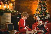 Lovely Baby Enjoy Christmas. Family Holiday. Childhood Memories. Santa Boy Celebrate Christmas At Ho poster