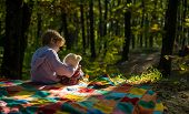 Boy Cute Child Play With Teddy Bear Toy Forest Background. Child Took Favorite Toy To Nature. Picnic poster