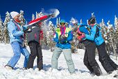 picture of snowball-fight  - Young people having snowball fight in snow in winter background - JPG
