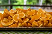 A Close Up View On Segments Of Freshly Sliced Oranges On A Tray At A Campsite, Healthy Eating As Peo poster