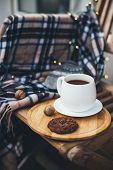 Still Life With Hot Tea And Chocolate Cookies On Wooden Tray With Warm Blanket And Festive Lights On poster