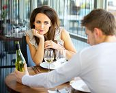 stock photo of fascinator  - Woman In Love On Romantic Date in Restaurant