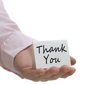foto of thank you note  - Businessman holding white thank you sign with white copy space - JPG