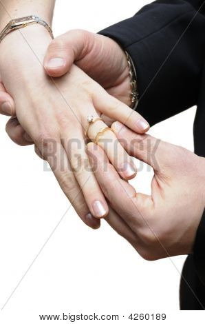 Groom Placing Ring On Finger