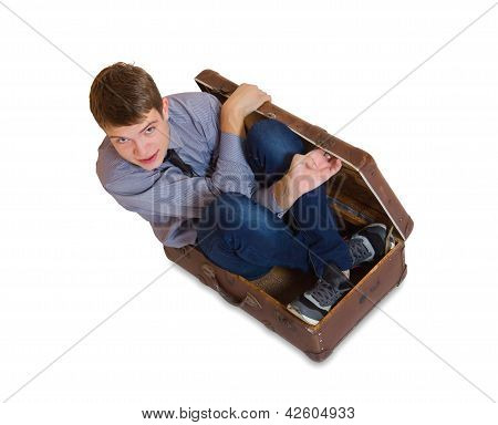 Man Sitting Inside Old Suitcase