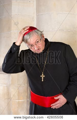 Cardinal with black cassock and red zucchetta or skullcap