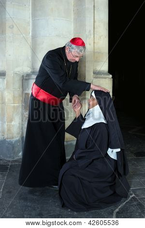 Kneeling nun greeting a cardinal in a medieval church