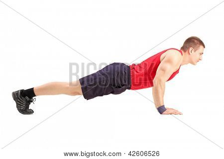 Male athlete in a sportswear doing push ups isolated on white background