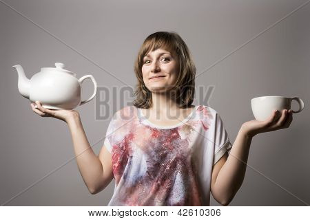 Woman With White Tea Cup And Tin