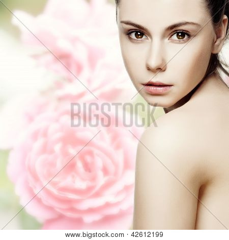 Beautiful Young Woman With Clean Skin Of The Face. Pretty Female Posing On White Background