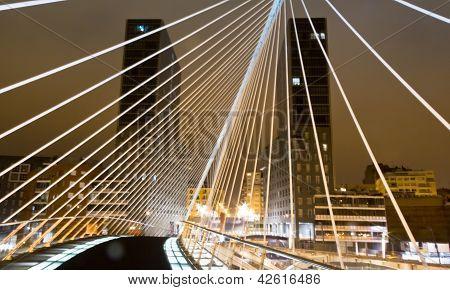 Nightview of Zubizuri bridge and Isozaki towers, in Bilbao