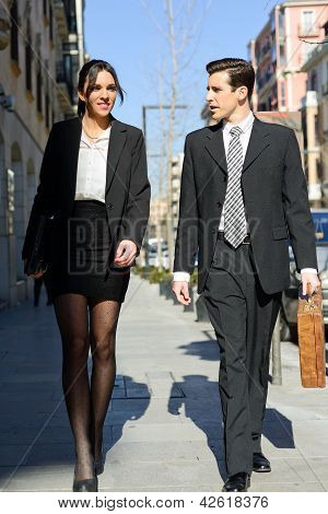 Attractive Business People Walking On The Street. Couple Working.